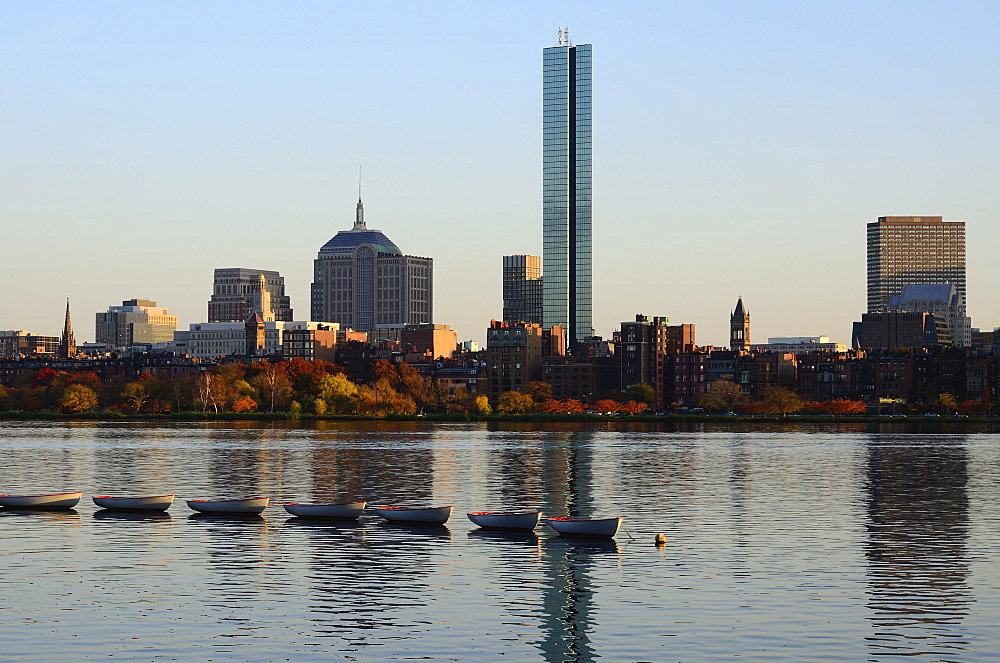 Row of boats on river, waterfront in background, Charles River, Boston, Massachusetts