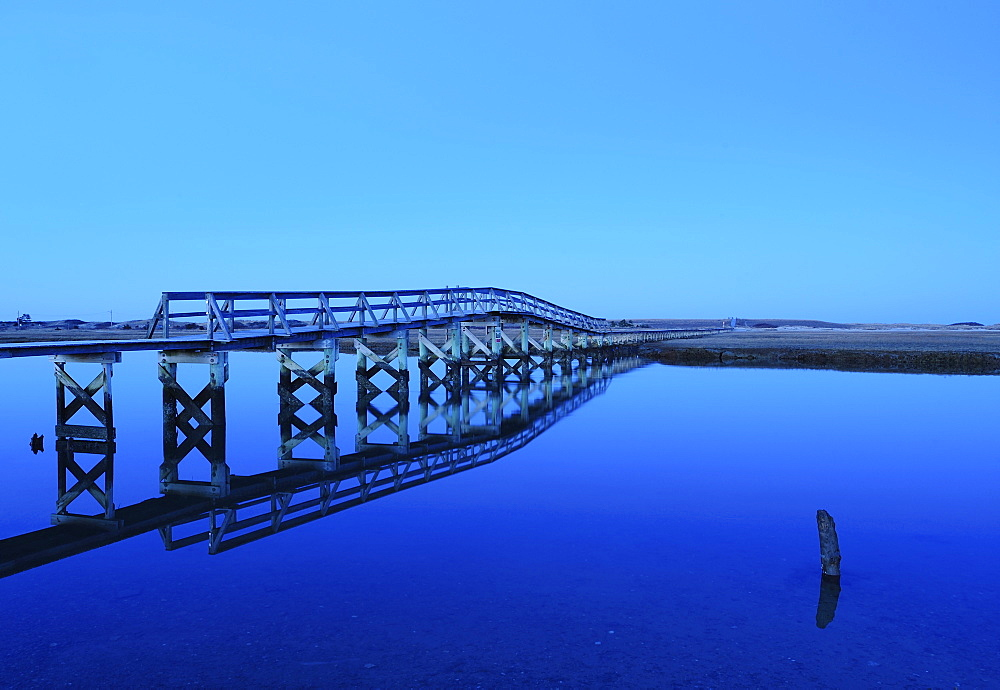 Bridge reflecting in water, blue image, Sandwich, Cape Cod, Massachusetts