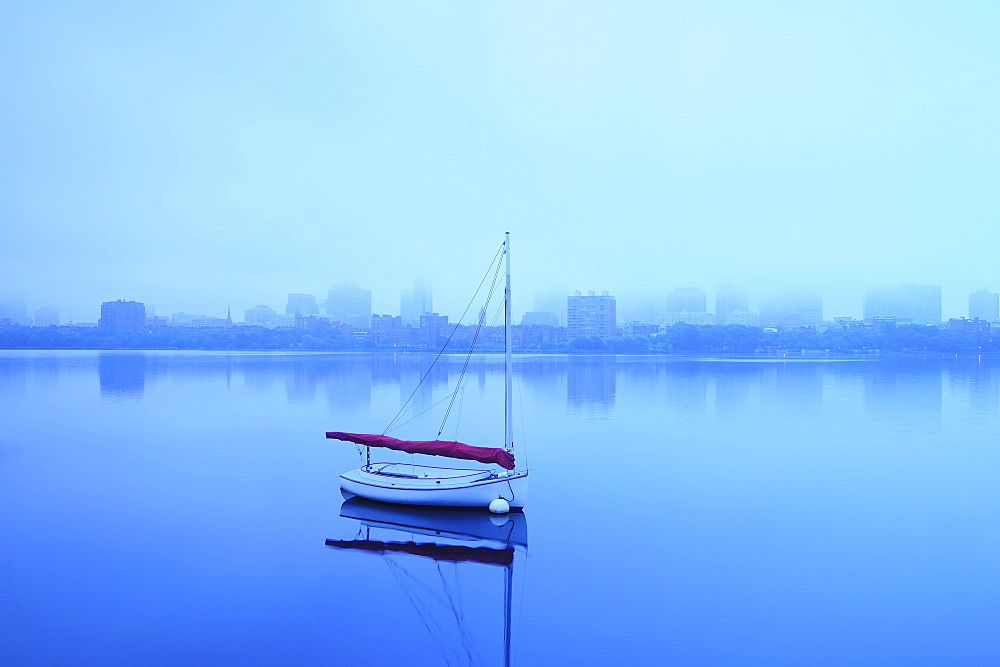 Charles River with boat shrouded in fog, Charles River, Boston, Massashusetts,USA