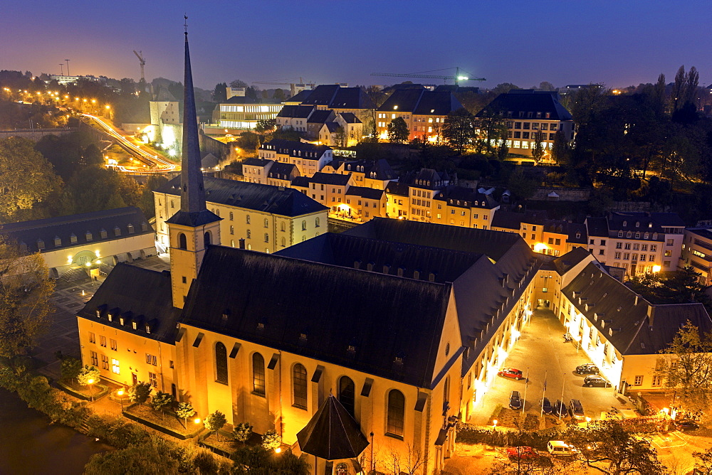Illuminated church and surrounding cityscape, Neumunster Abbey, Luxembourg City, Luxembourg