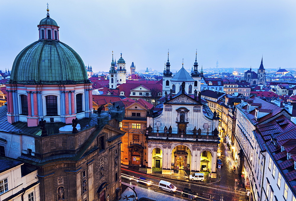 Cityscape with dome and illuminated buildings, Prague, Czech Republic