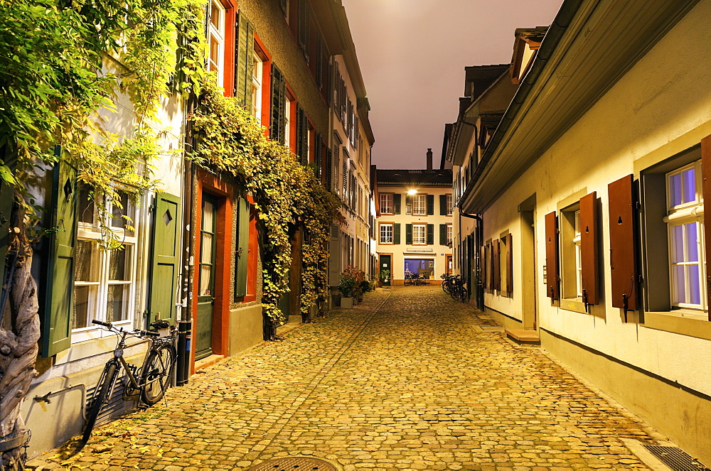 View along illuminated old town street, Basel, Basel-Stadt, Switzerland