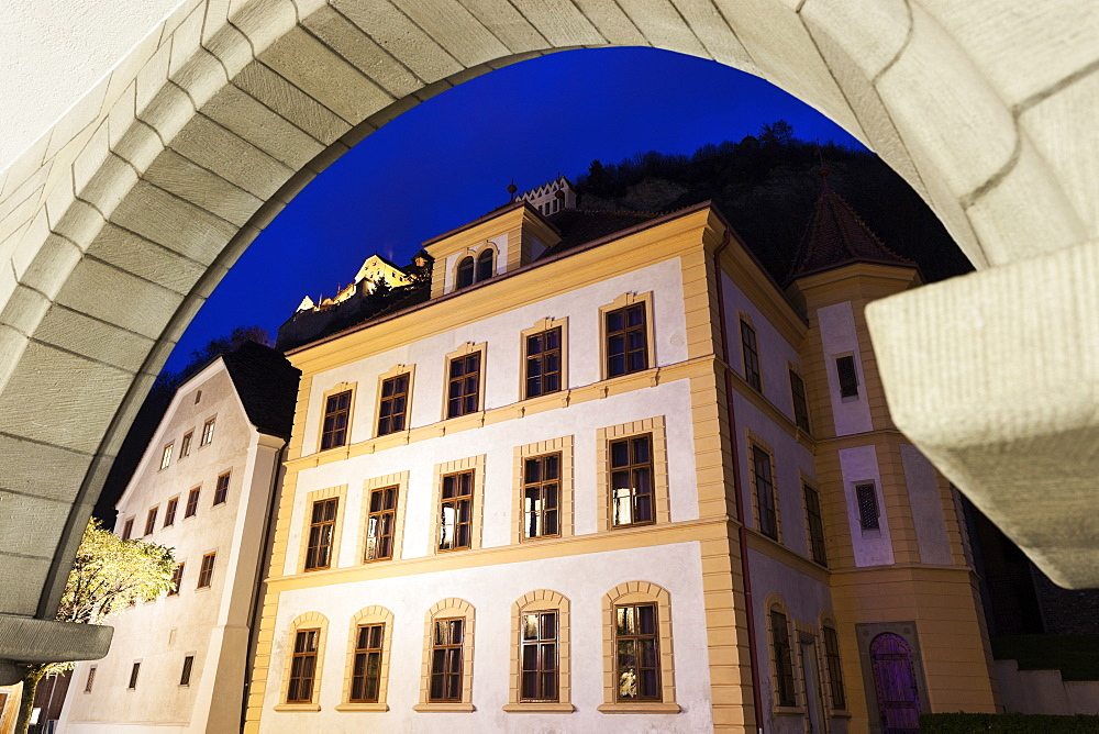 Liechtenstein National Museum seen through arch, Liechtensteinisches Landesmuseum and Vaduz Castle - Vaduz, Liechtenstein