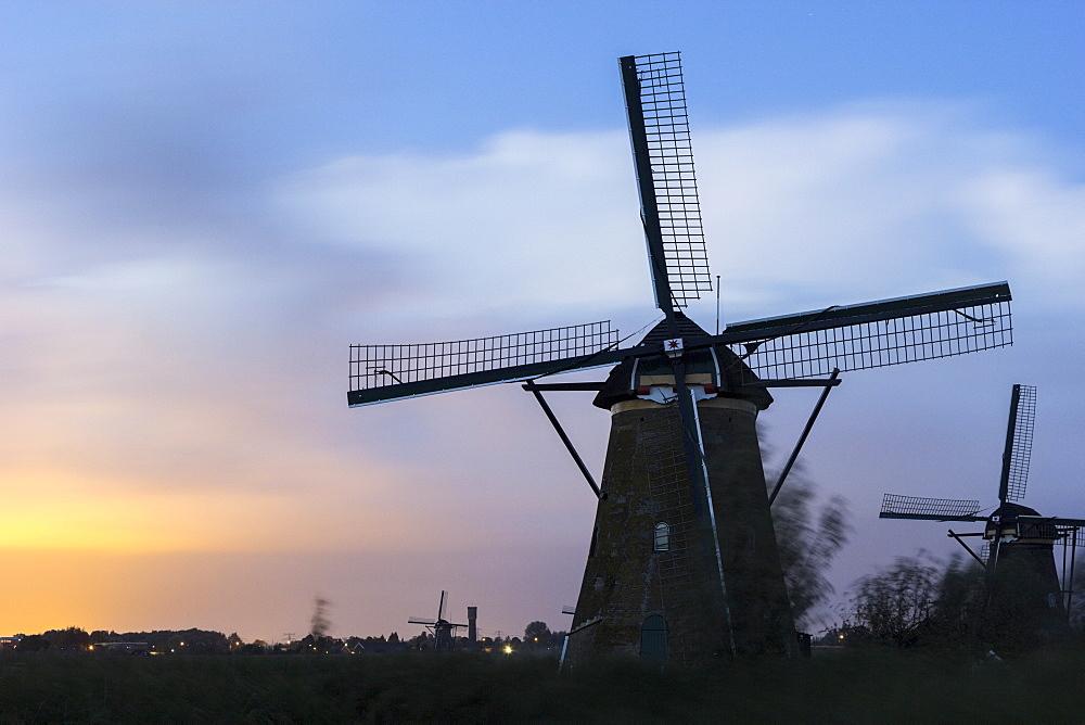 View of windmills at sunset, Kinderdijk, South Holland, Netherlands