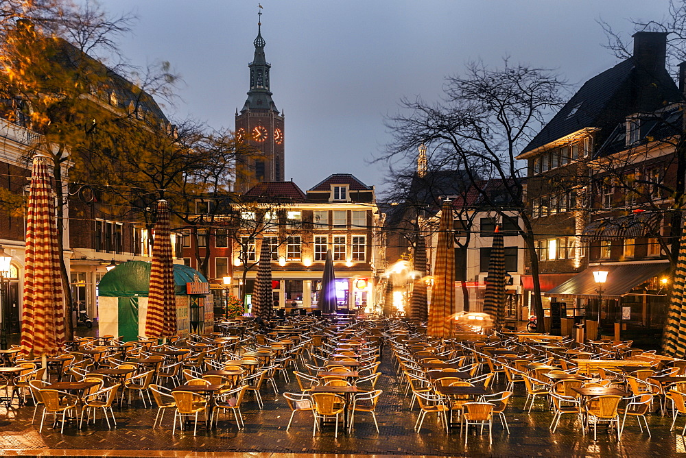 Town square with cafe tables, Gothic St. James Church,The Hague, South Holland, Netherlands