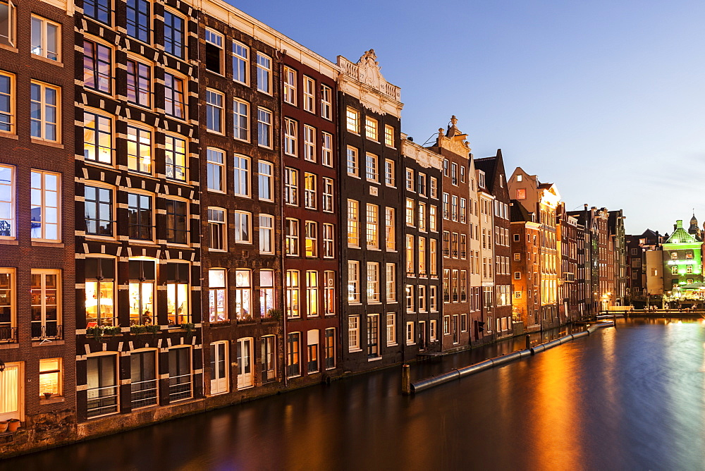 Buildings by canal at sunrise, Amsterdam, North Holland, Netherlands