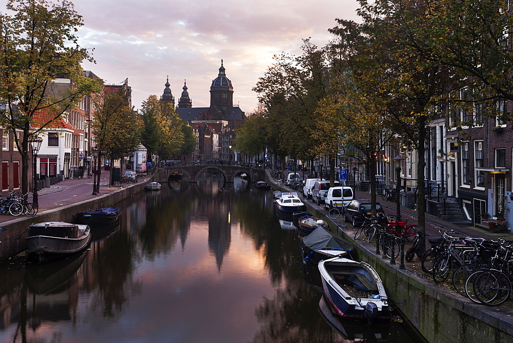 Water canal in city at sunrise, Amsterdam, North Holland, Netherlands