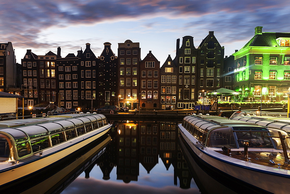 Boats in canal at sunrise, Amsterdam, North Holland, Netherlands