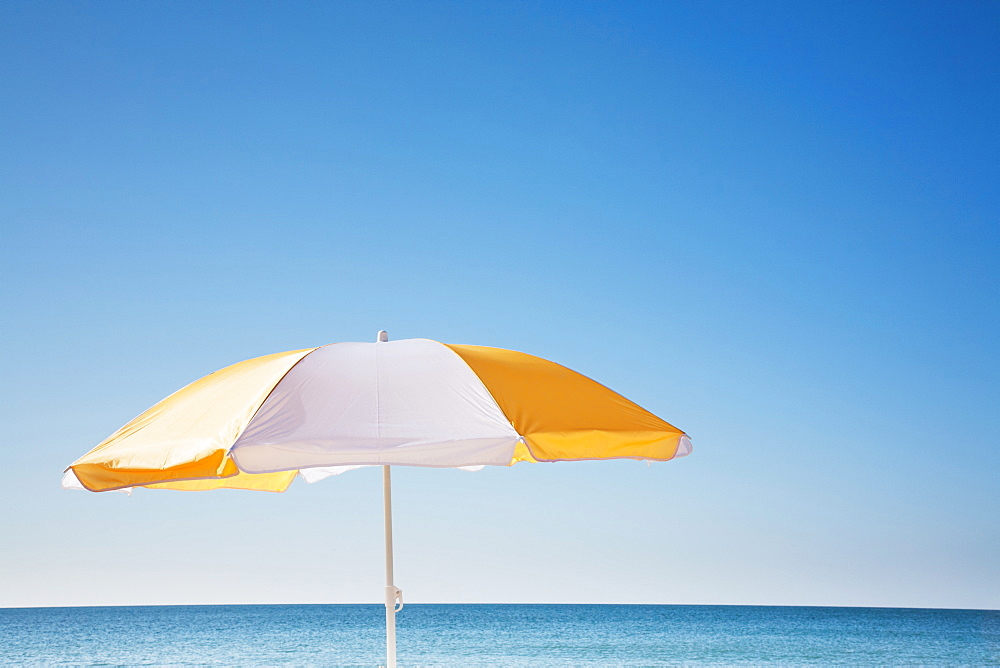 Beach umbrella by sea, Nantucket, Massachusetts, USA