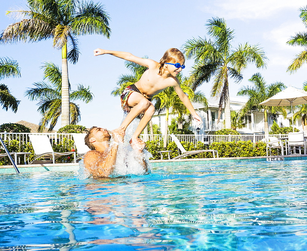 Man swimming with his brother (8-9), Florida,USA