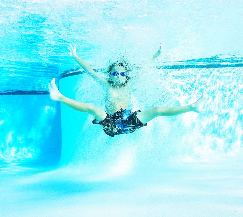 Portrait of boy (8-9) in swimming pool, Florida,USA