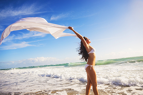 Woman in white bikini on beach, Jupiter, Florida,USA