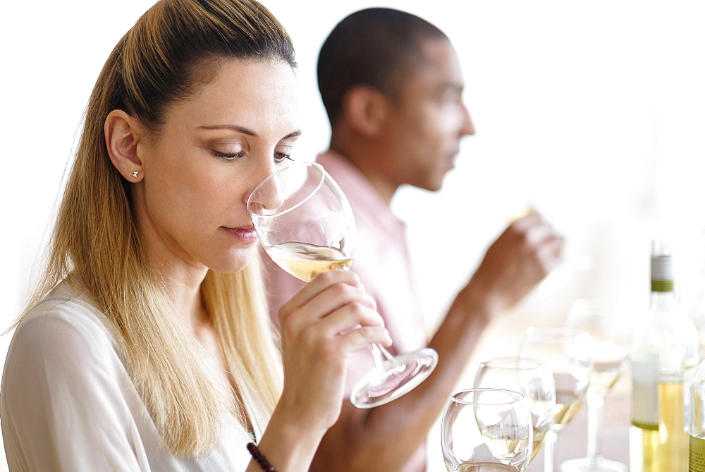 Man and woman tasting white wine