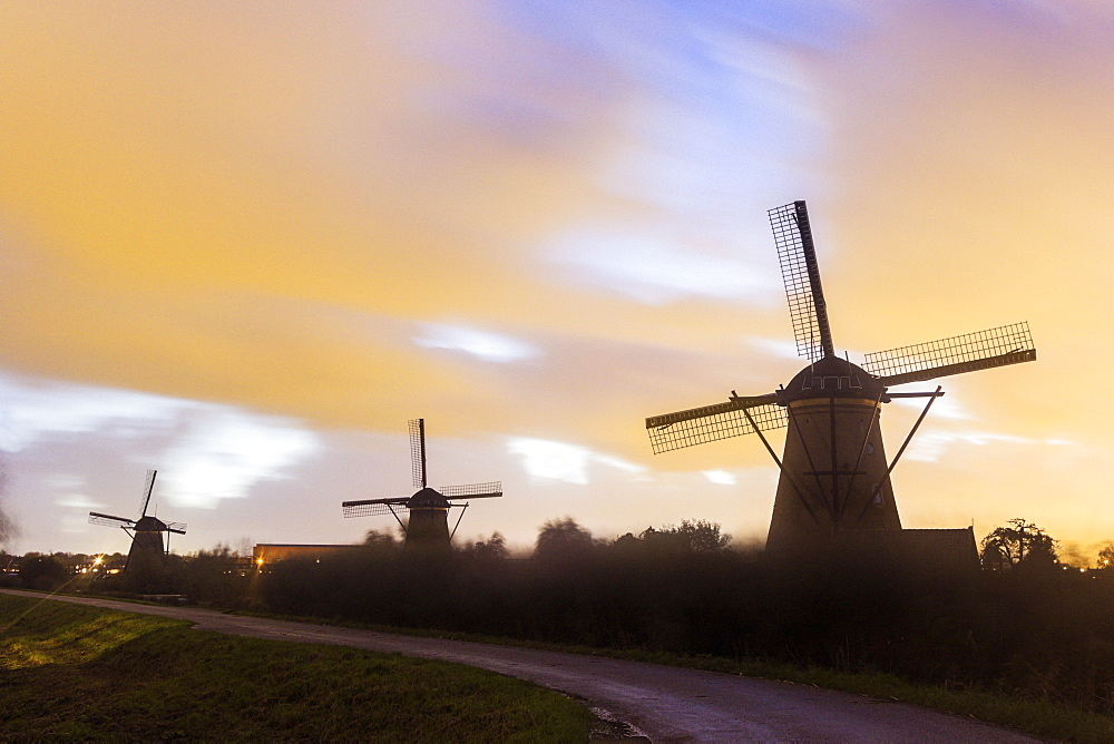 Traditional windmills at sunset, Netherlands, South Holland, Kinderdijk