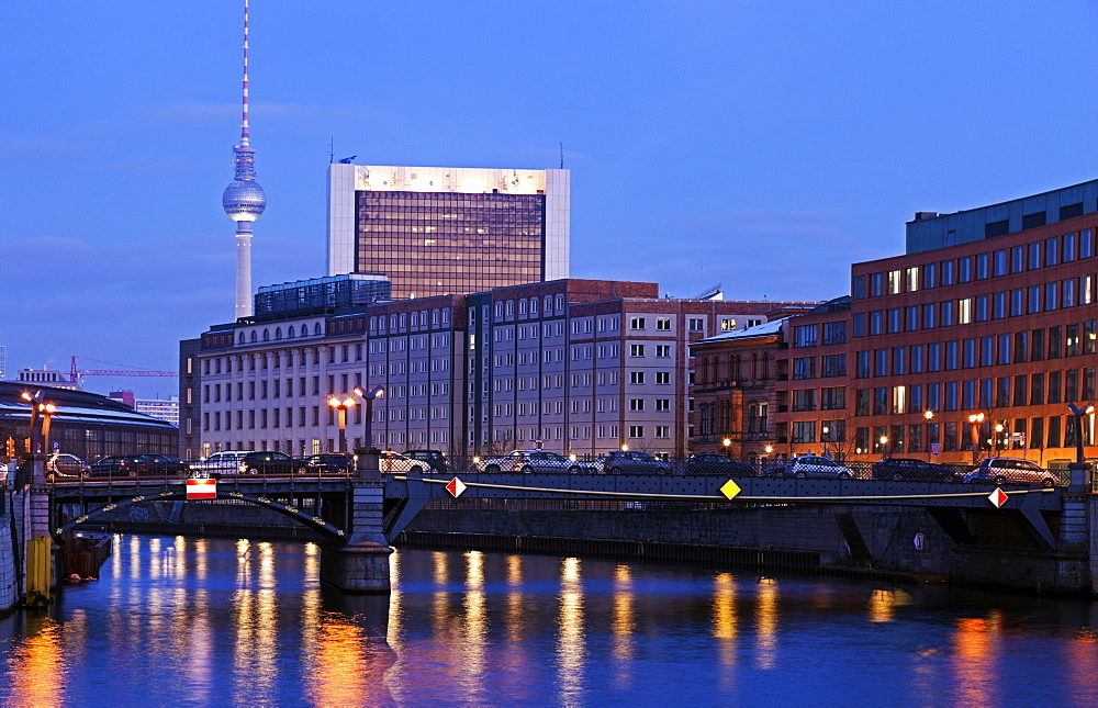 Illuminated riverfront skyline with television tower, Germany, Berlin, Berlin TV Tower, River Spree