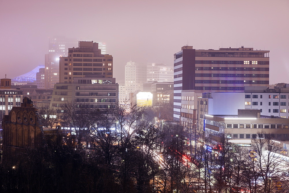 Illuminated cityscape in fog, Germany, Berlin