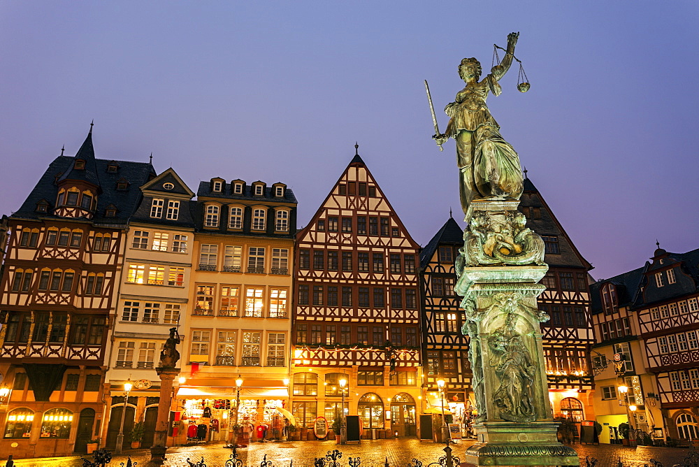 Statue on illuminated square, Germany, Hesse, Frankfurt, Romerberg Plaza
