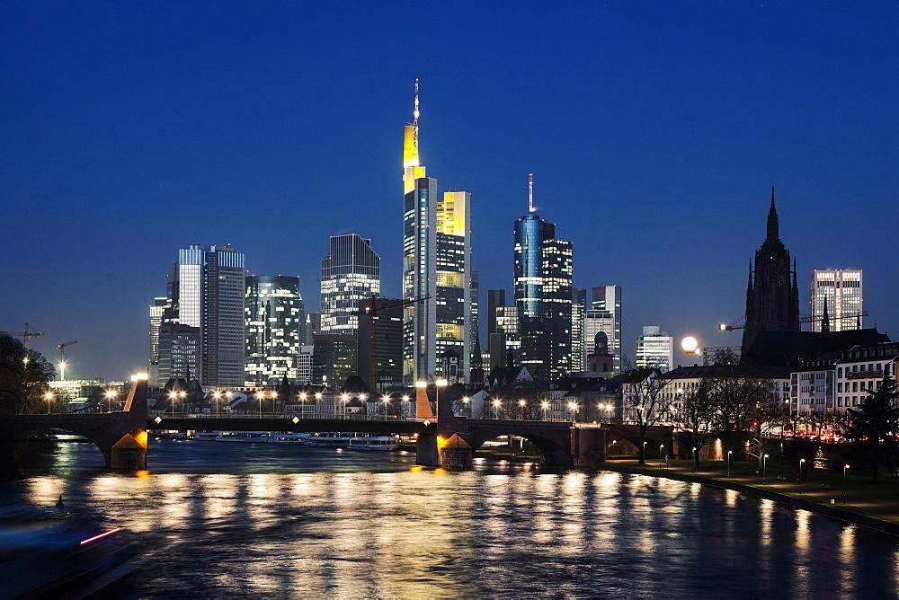 Illuminated riverfront skyline, Germany, Hesse, Frankfurt