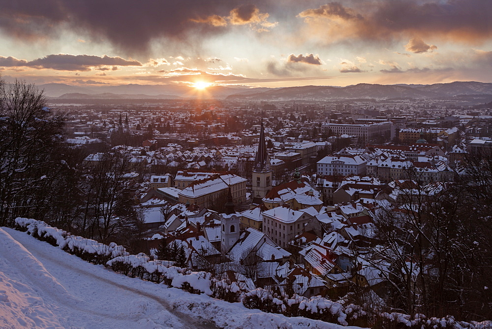 Winter cityscape at sunrise, Slovenia, Ljubljana, St. Florian's Church, St. James's Parish Church