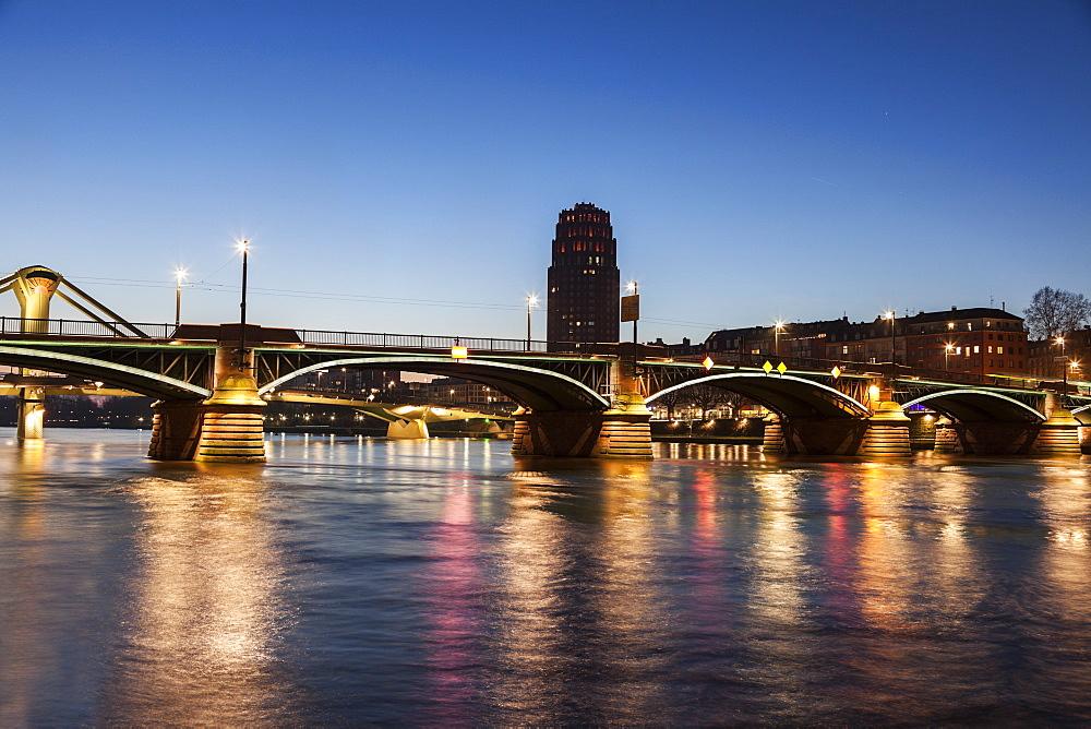 Ignatz-Bubis Bridge illuminated at dusk, Germany, Hesse, Frankfurt, Ignatz-Bubis Bridge