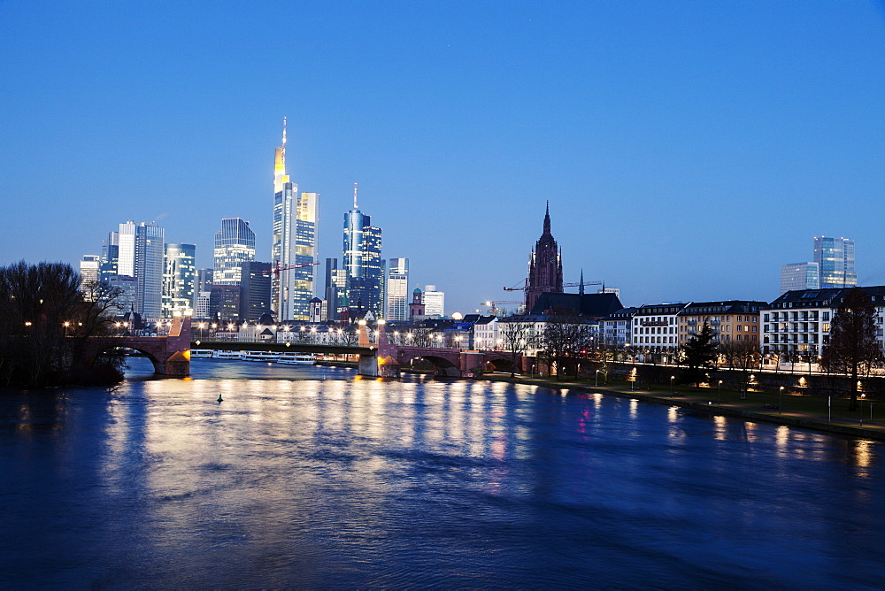 Illuminated skyline at dusk, Germany, Hesse, Frankfurt