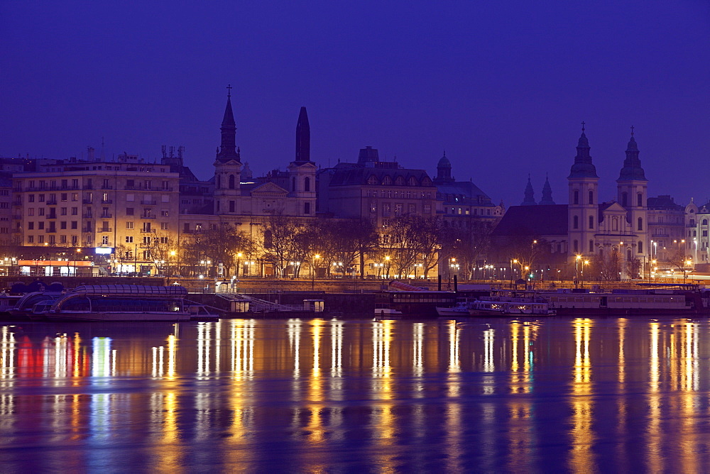 Illuminated waterfront and reflections in river, Hungary, Budapest, Budapest Churches