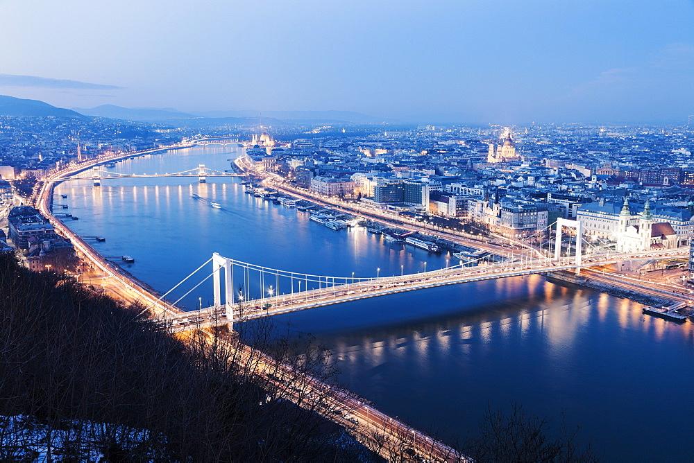 Waterfront cityscape with illuminated Elisabeth Bridge, Hungary, Budapest, Elisabeth Bridge, Chain Bridge