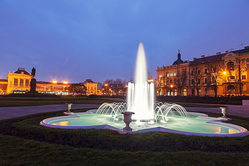 Illuminated fountain at night, Croatia, Zagreb, railway station, fountain,King Tomislav Square