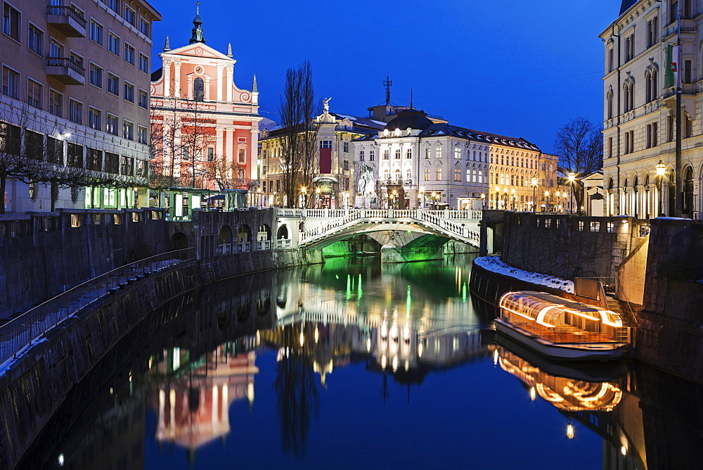 Illuminated buildings and Ljubljanica River, Slovenia, Ljubljana, Franciscan Church