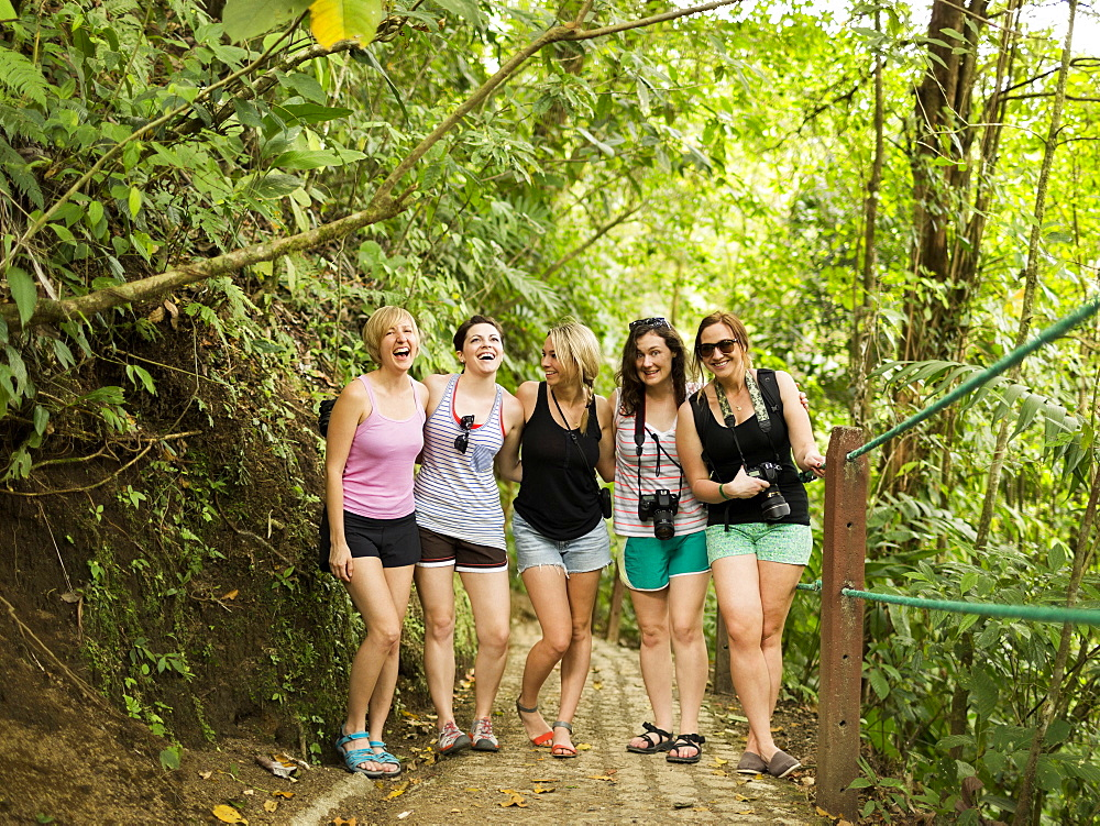 Young women on footpath in forest, Costa Rica