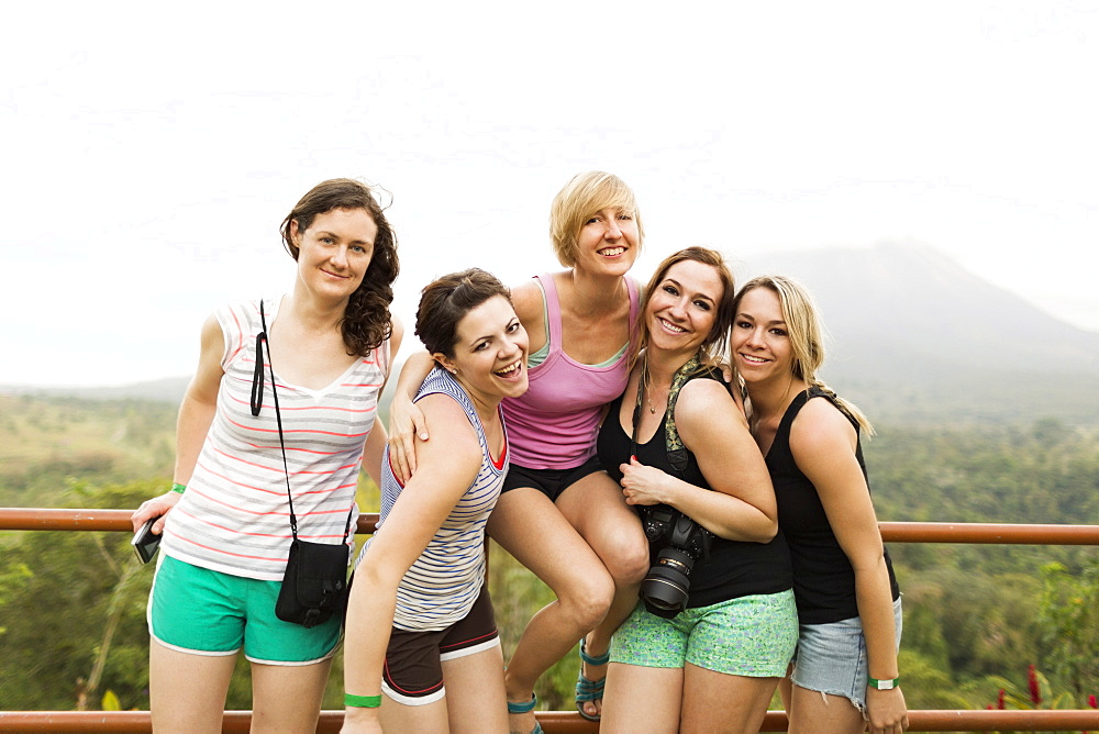 Smiling women by railing, Costa Rica