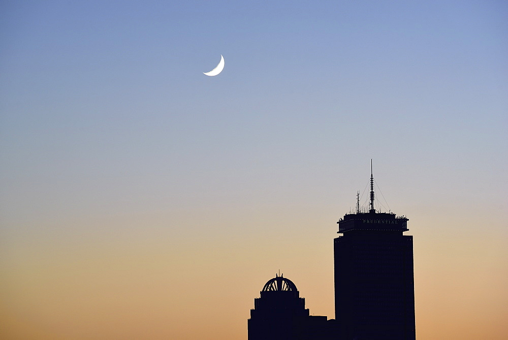 Crescent moon above office buildings, USA, Massachusetts, Boston, Back Bay