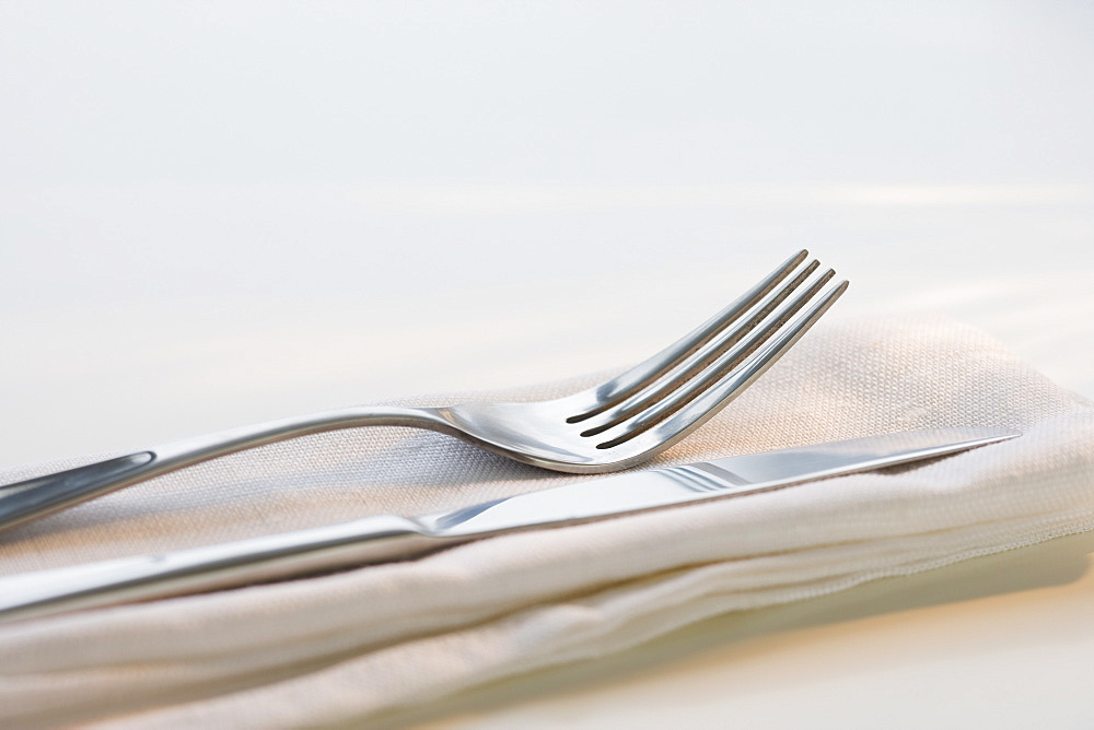 Close up of silverware on napkin