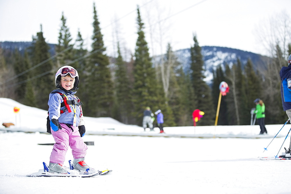 Little girl (2-3) learning skiing , USA, Montana, Whitefish