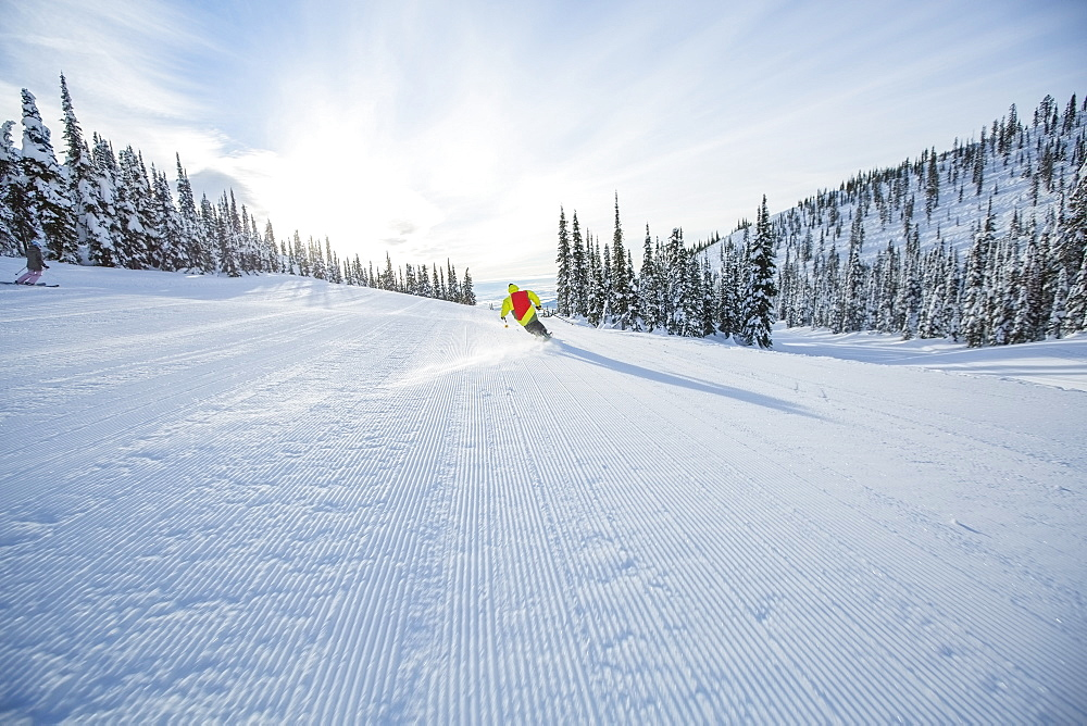 Young man speeding on ski slope, USA, Montana, Whitefish