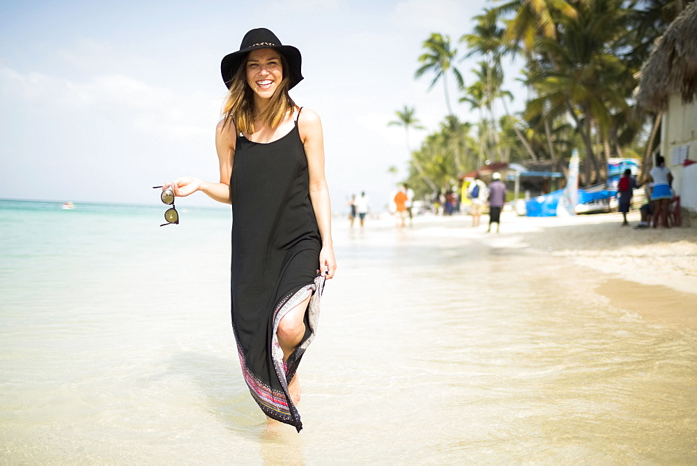 Woman walking on beach, Dominican Republic