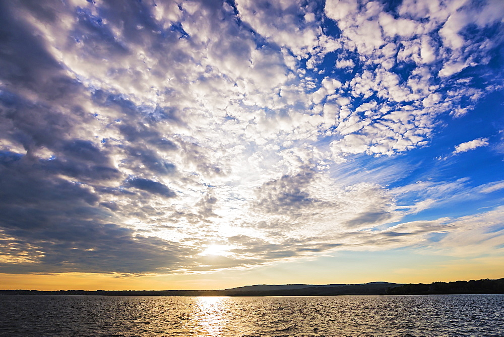 Cloudy sky above bay at sunset, USA, Maine, Rockland