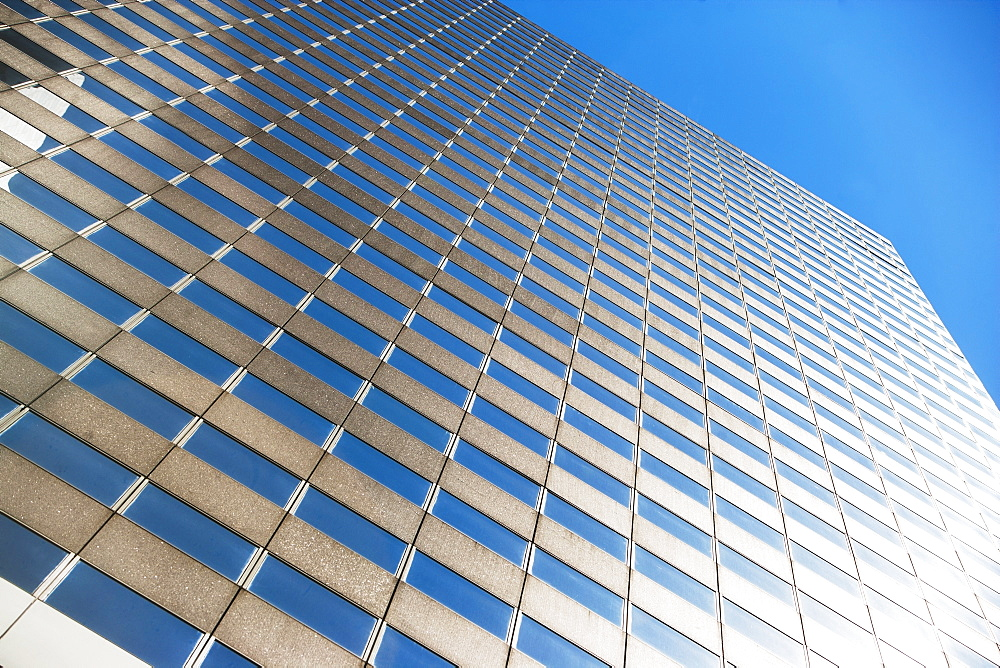Low angle view of skyscraper against blue sky, USA, New York State, New York City