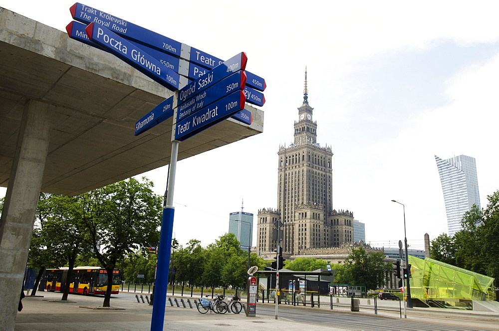 Sign post with Palace of Culture and Science in background, Poland, Warsaw