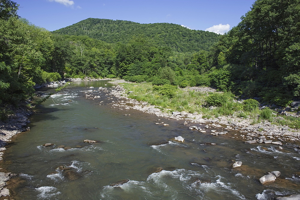 View of river on sunny day, USA, New York State, Catskills