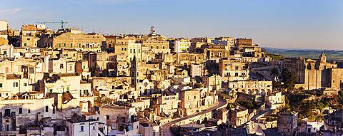 Italy, Basilicata, Matera, Panorama of old town at sunset