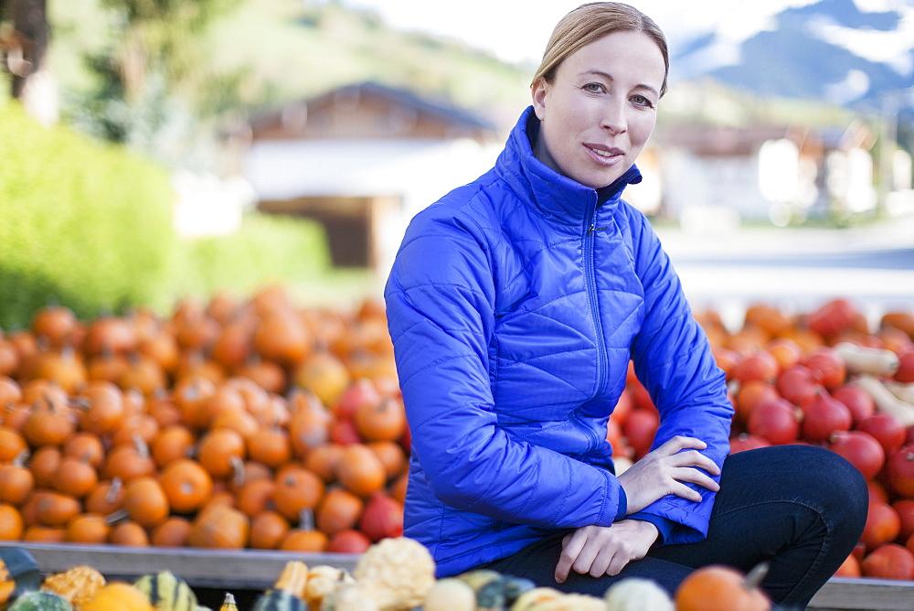 Austria, Salzburger Land, Maria Alm, Portrait of mature woman in blue jacket