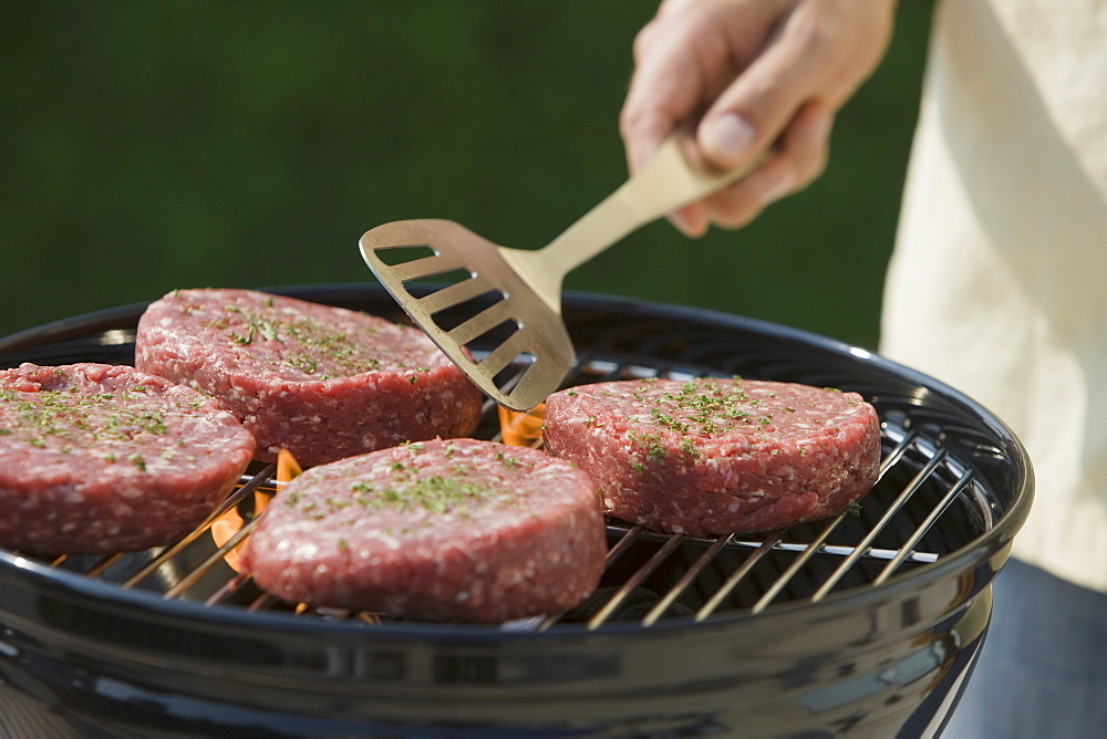 Close up of hamburgers on barbecue grill