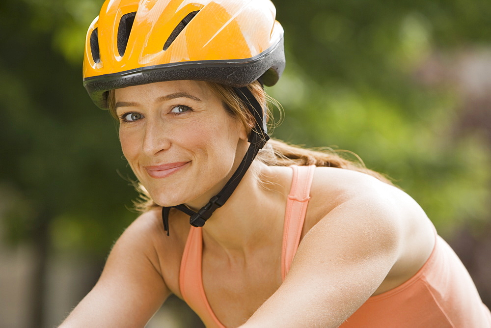 Woman wearing bicycle helmet