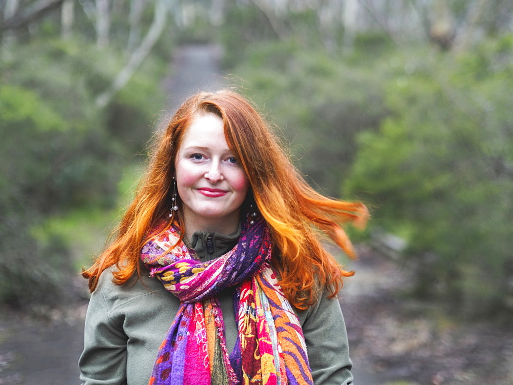Portrait of smiling redhead woman in scarf