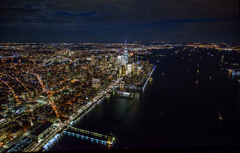 USA, New York, New York City, Aerial view of illuminated skyline at night