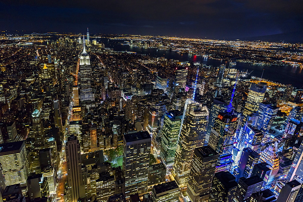 USA, New York, New York City, Manhattan, Aerial view of illuminated skyline at night