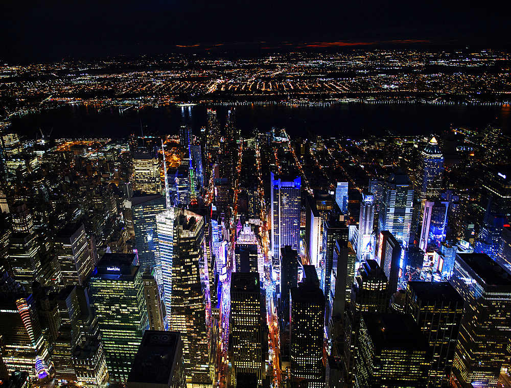 USA, New York, New York City, Manhattan, Aerial view of illuminated skyline with Times Square at night