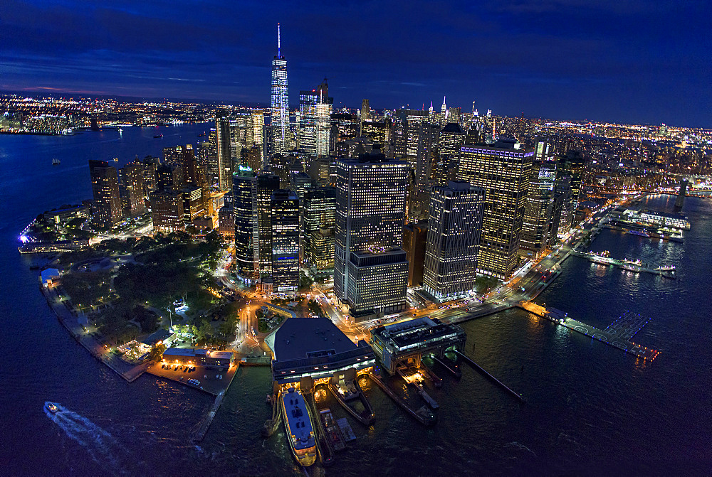 USA, New York, New York City, Manhattan, Aerial view of illuminated skyline with harbor at night - 1178-25830