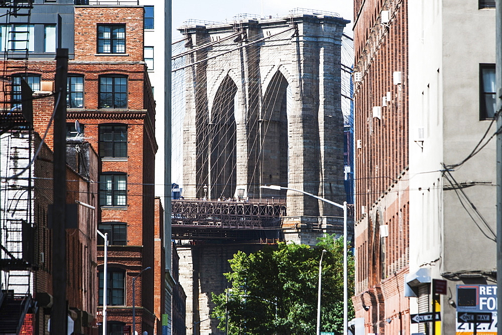 USA, New York State, New York City, Brooklyn Bridge arches seen from between buildings